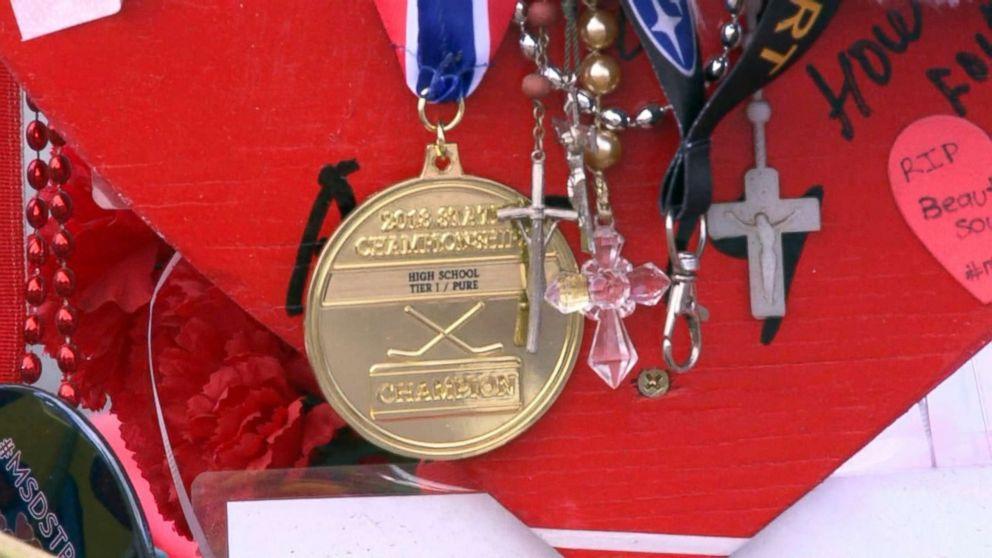 Stoneman Douglas hockey team wins championship, drapes medals on victims' memorial