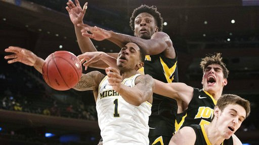 No. 15 Michigan overcomes Iowa in OT 77-71 in Big Ten