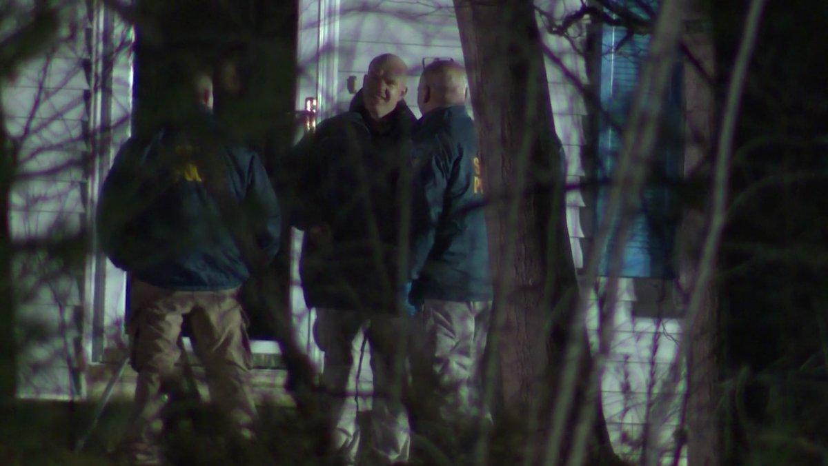 Crime scene investigators remain at home where 4 found dead