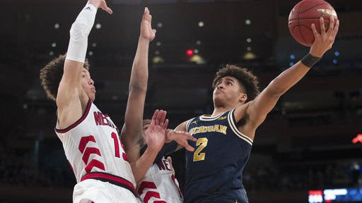 No. 15 Michigan deals blow to Nebraska's NCAA hopes, 77-58