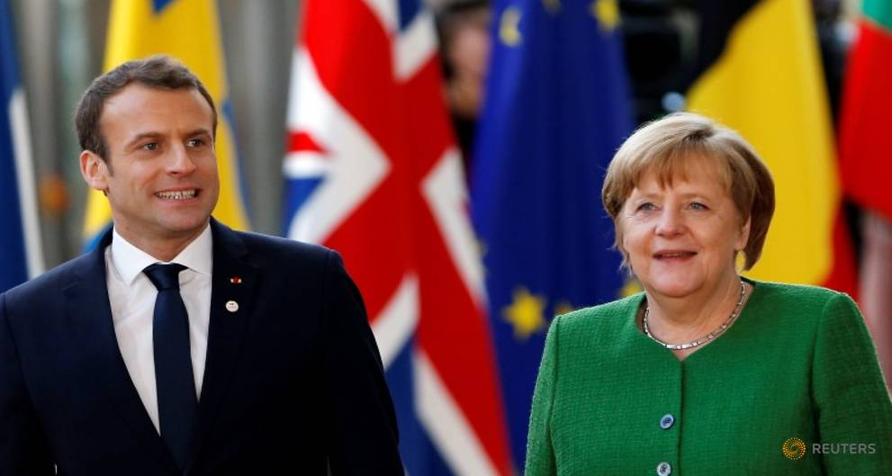 Faced with US tax cuts, France, Germany hasten harmonisation - Merkel