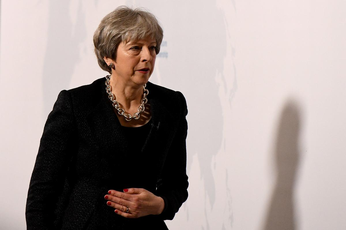 May defends stance on post-Brexit financial services rules