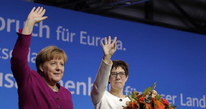 After five months, Merkel finally assembles a shaky coalition in Germany
