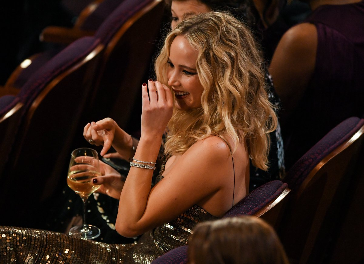 Jennifer Lawrence Drinking Wine And Scaling Furniture At The Oscars Will Make Your Morning