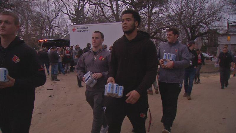U of L football team helps flood victims clean up Riviera neighborhood