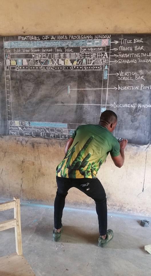 New Word order: Ghanaian teacher uses blackboard to explainsoftware
