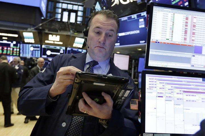 @BroadcastImagem: Operadores trabalham no pregão da Bolsa de Valores de Nova York nesta quarta-feira. Richard Drew/AP
