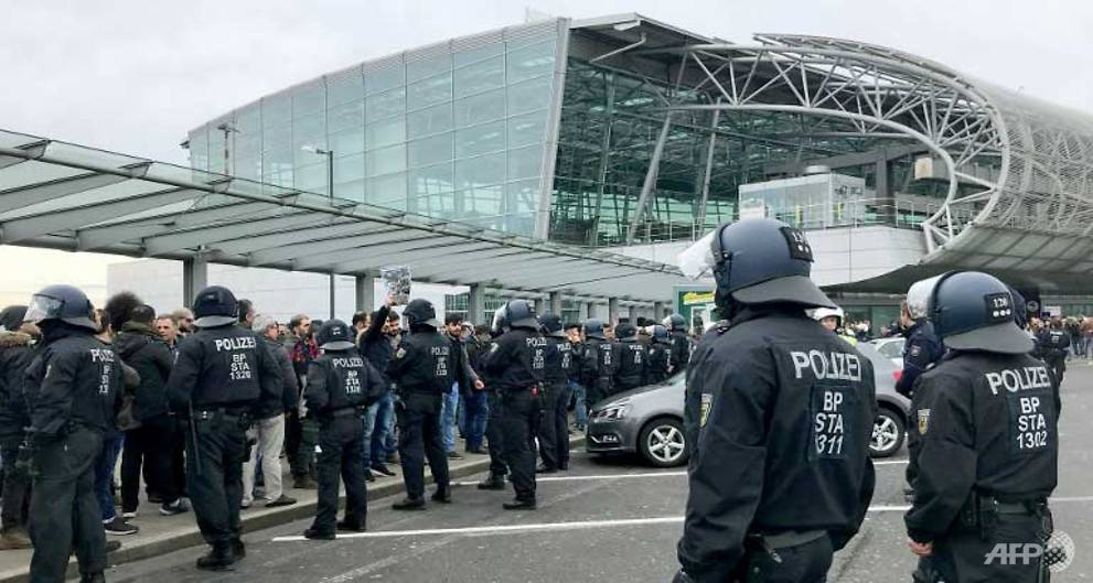 Kurdish protesters clash with police at German airport, disrupt UK stations