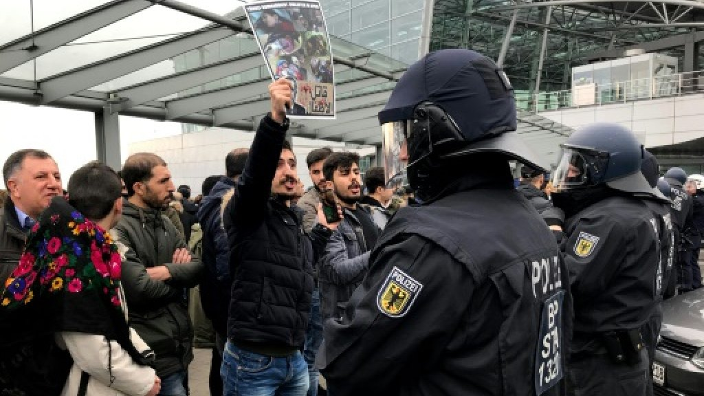 Kurdish protesters clash with police at German airport