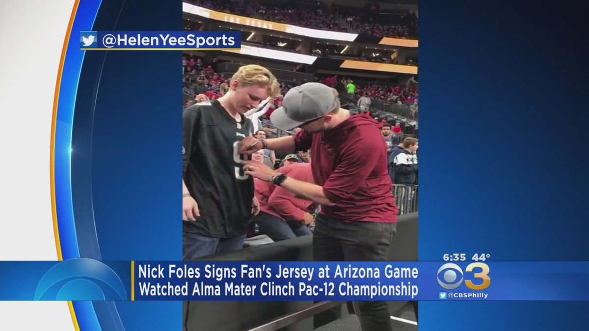 Nick Foles Signs Eagles Fan's Jersey At Pac-12 Tournament