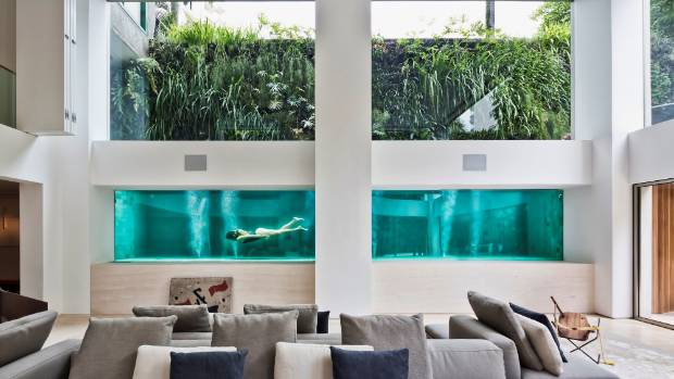São Paulo apartment has a glass pool in the living room