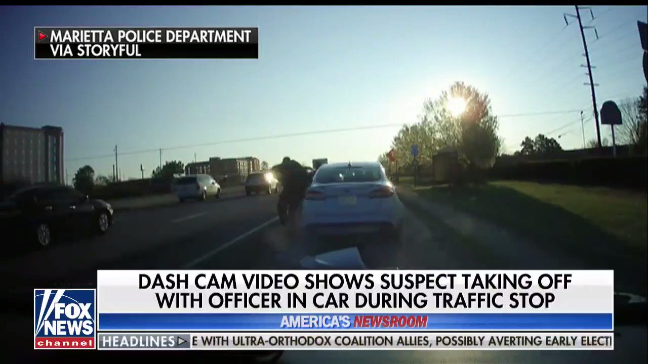 Dash cam video shows suspect taking off with officer in car during traffic stop https://t.co/CaIrGNF0u7