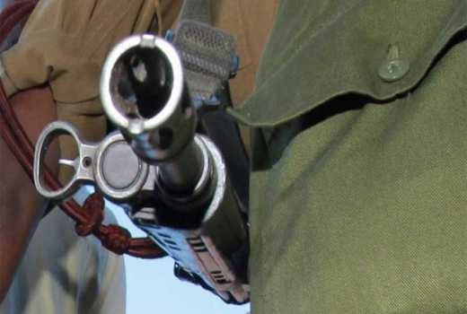 Police officers shoot brothers in land row