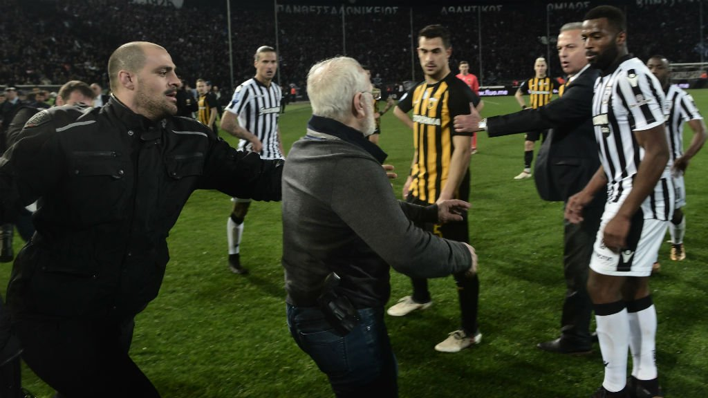 Greek football league suspended after team owner invades pitch with gun