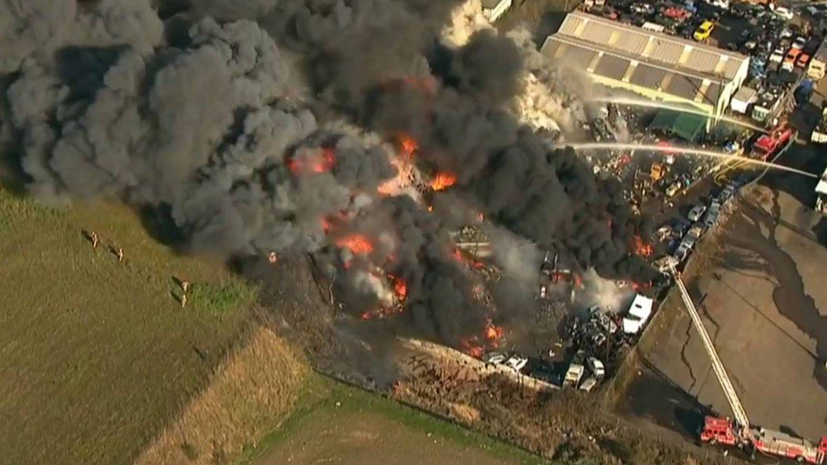 Large fire burning at auto salvage yard in NE Portland