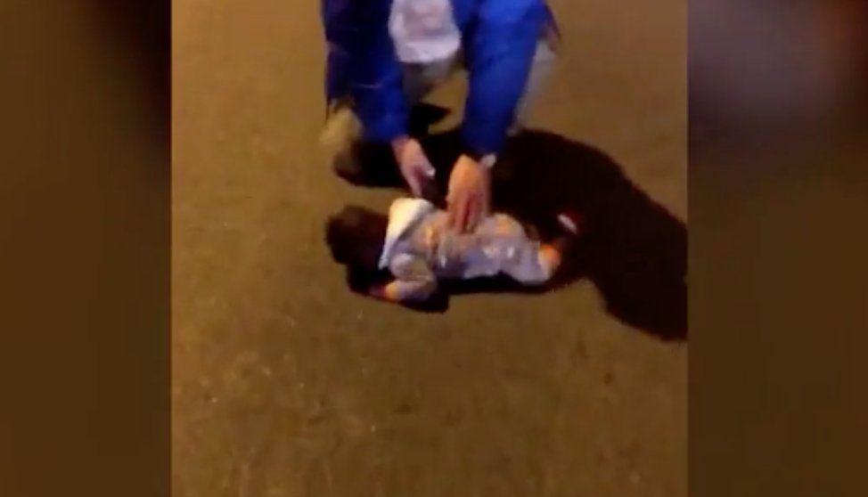 Mom arrested after heartbreaking video shows baby lying in middle ofroad