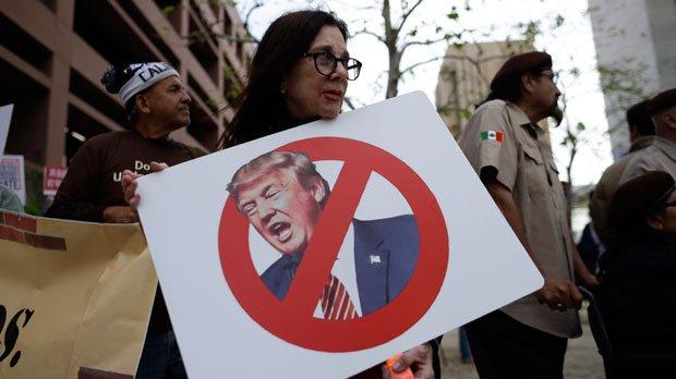 Protestors emerge as Trump visits California border
