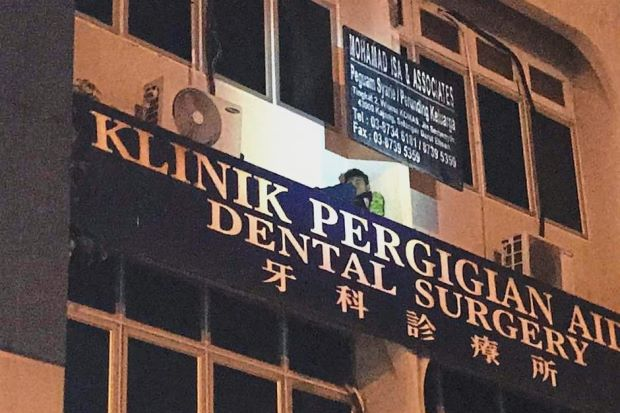 Suspect caught hiding behind signboard - Nation