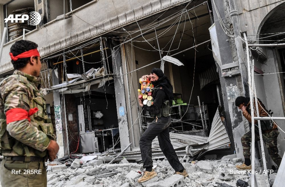Pro-Turkish forces pillage Afrin after taking Syrian city https://t.co/kiD8EZmQrx https://t.co/OgcG0EbJxG