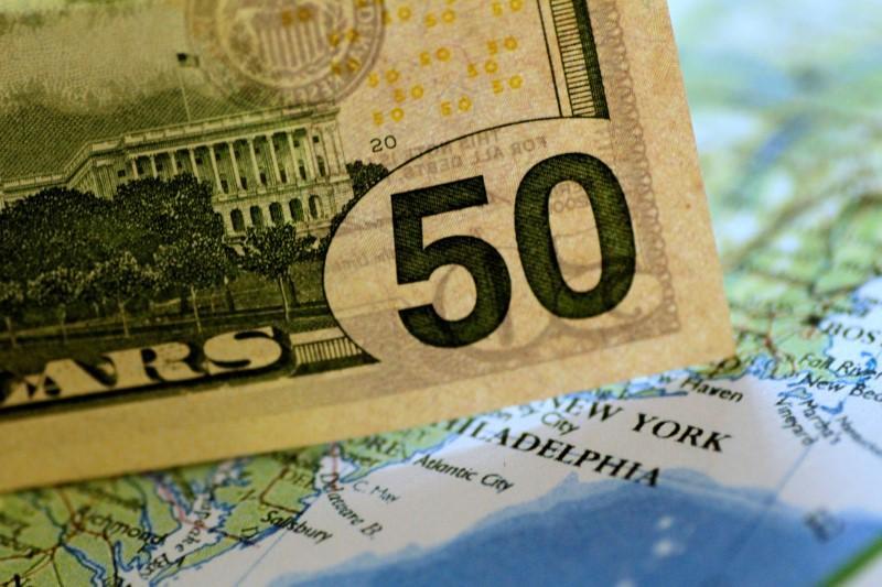 Dollar firmer as market eyes Fed meeting; yen edges higher