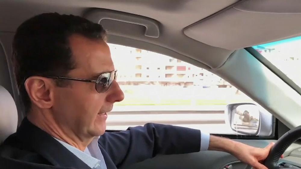 President Bashar al-Assad filmed driving himself to the Syrian civil war's front line