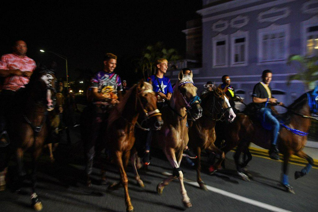 Riding horses and banging drums, Puerto Ricans demand that governor quit
