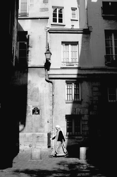 Framed. Waited. Perfect lighting for the shot. Nun walks into scene. Paris #streetphotography #parisstreetphotography https://t.co/rMJPAJuhf3