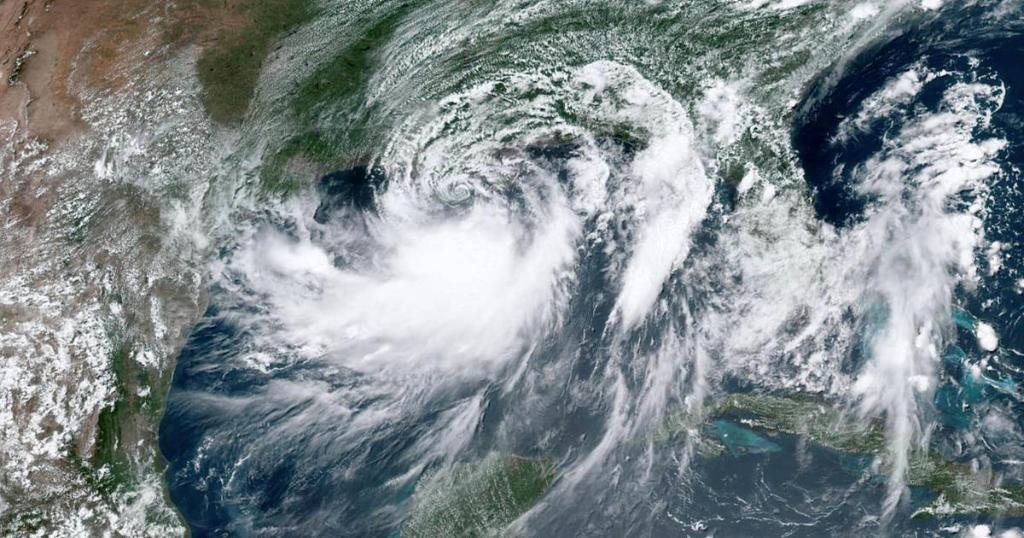 Barry strengthens into a hurricane as it lashes Louisiana coast - live updates