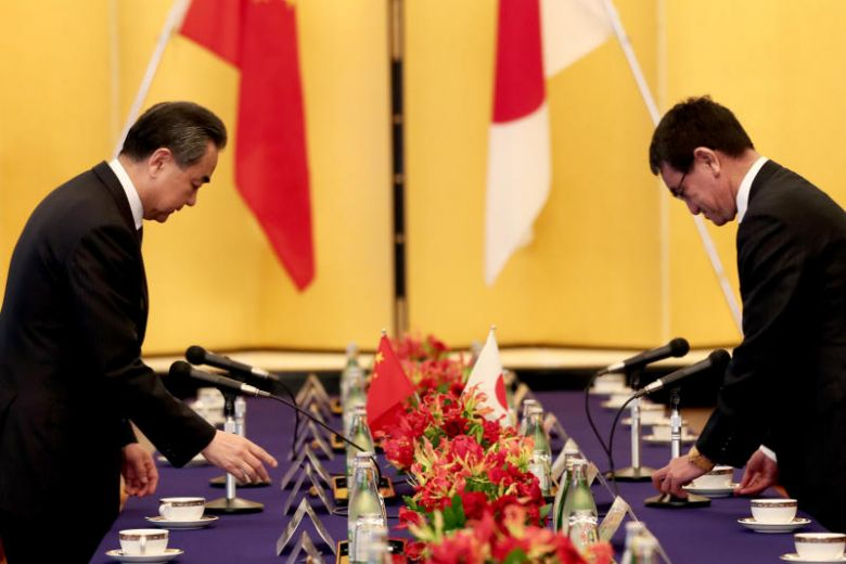 Japan and China turn the page on fraught ties, with Chinese foreign minister in Tokyo
