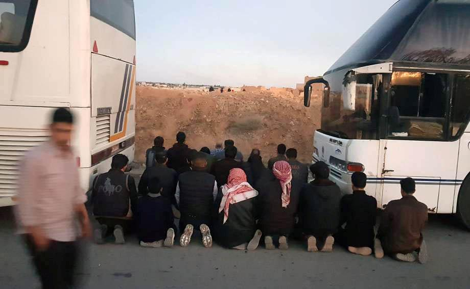 Rebel fighters begin leaving Syria's Douma after weeks-long military assault