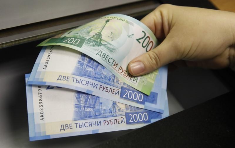 Russia's ruble, Rusal, Sberbank take hits as US sanctions bite