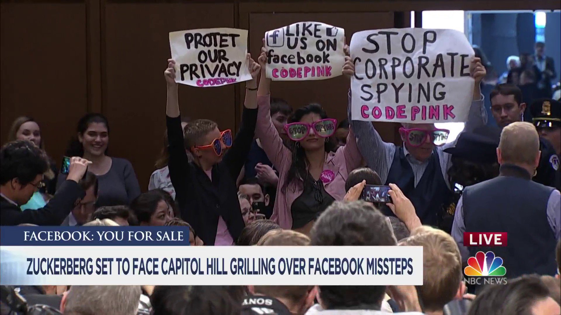 @frankthorp Demonstrators stand and protest ahead of Zuckerberg congressional hearing. https://t.co/q55BstfZ1p https://t.co/ehsfogicE1