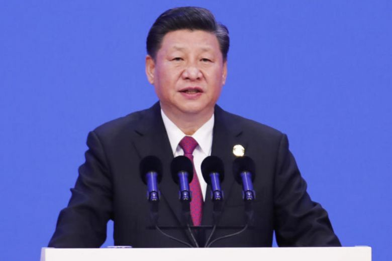 China says Xi pledges to open up the economy unrelated to US trade spat