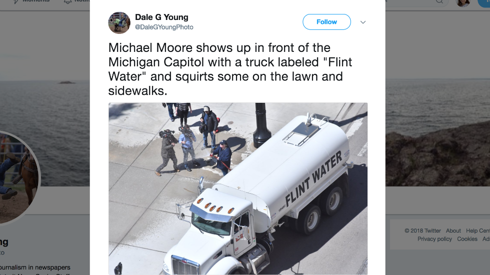 Michael Moore sprays 'Flint Water' at Michigan Capitol, tells GOP governor to drink it https://t.co/loyGqMKLjg https://t.co/7nHMmWOq3f
