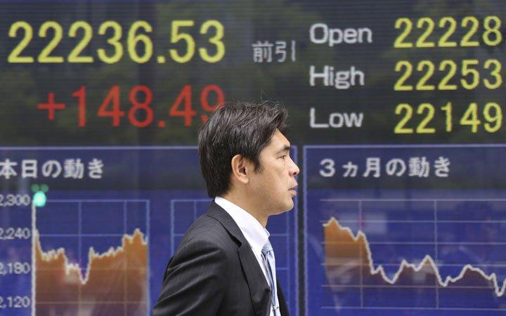 @BroadcastImagem: Bolsas da China e Tóquio fecham em alta, mas tecnologia pesa na Coreia e Taiwan. Koji Sasahara/AP
