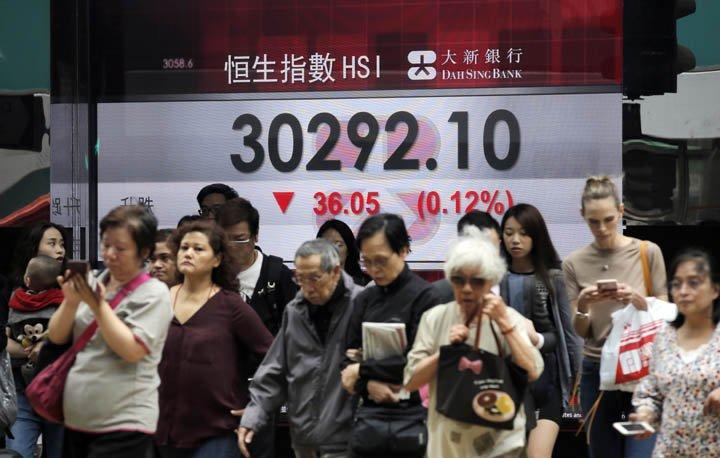 @BroadcastImagem: Bolsas asiáticas seguem Wall Street e fecham sem direção única. Kin Cheung/AP