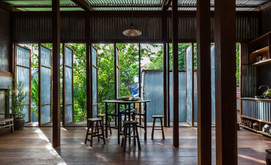 """Nishizawa Architects has replaced the facade and interior walls of this residence in Vietnam's An Giang province with moveable corrugated metal panels to create a """"half-outdoors"""" dwelling for three families. https://t.co/tWSwDRNRvl"""