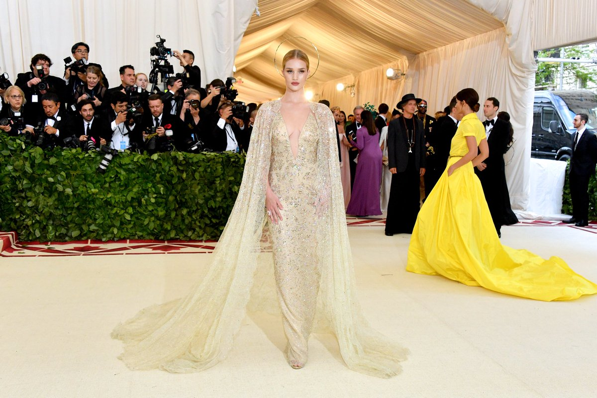 Rosie huntington-whiteley wears a caped ralph lauren collection gown ...