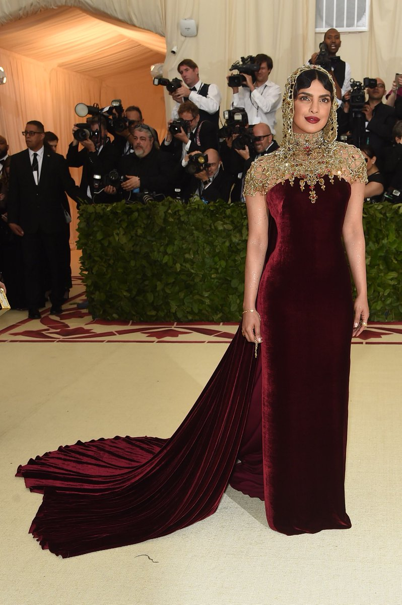 in a ralph lauren collection velvet evening gown with gold ...