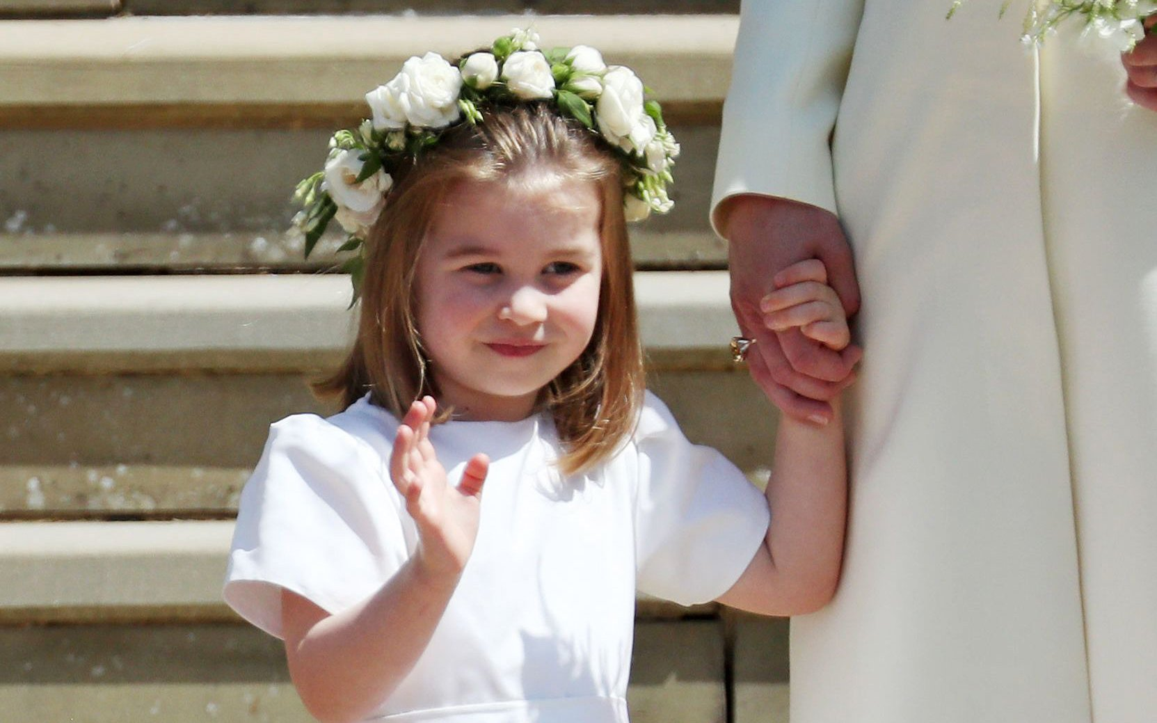 Princess Charlotte of Cambridge gives a wave at the #RoyalWedding https://t.co/Oqw4xZ724f https://t.co/oZjjjlX4xa