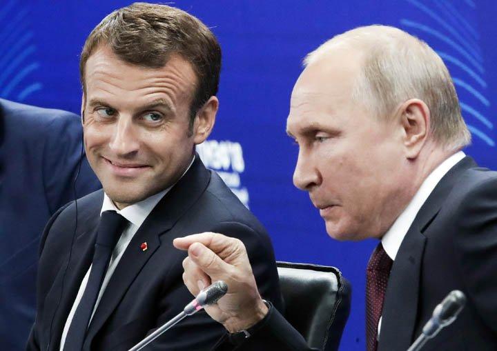 @BroadcastImagem: Macron e Putin participam de encontro econômico em São Petersburgo, na Rússia. Dmitri Lovetsky/AP