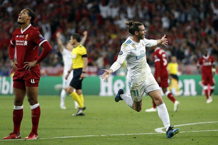@BroadcastImagem: Com dois gols de Bale, Real vence Liverpool por 3 a 1 e fatura a 13ª Liga dos Campeões. Pavel Golovkin/AP