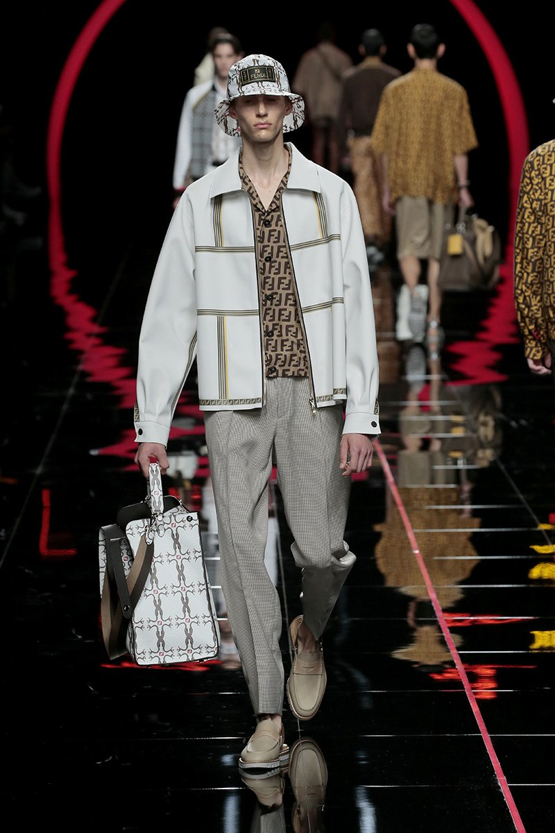 Fendi presents stripes running askew on sheer shirts and hints of FF and Pequin #FendiSS19 #MFW https://t.co/jLkQwsnB2i