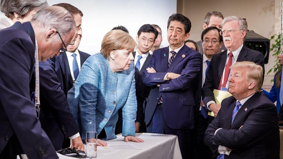 Here's what was really happening in that photo of Trump at the G7