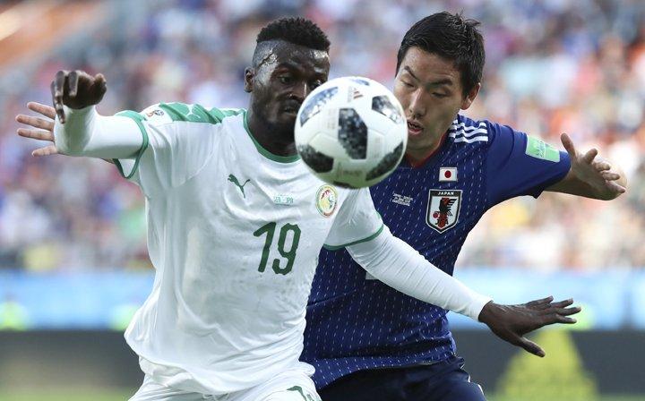 @BroadcastImagem: Em jogo marcado por recordes, Japão e Senegal empatam e seguem juntos na ponta. Eugene Hoshiko/AP