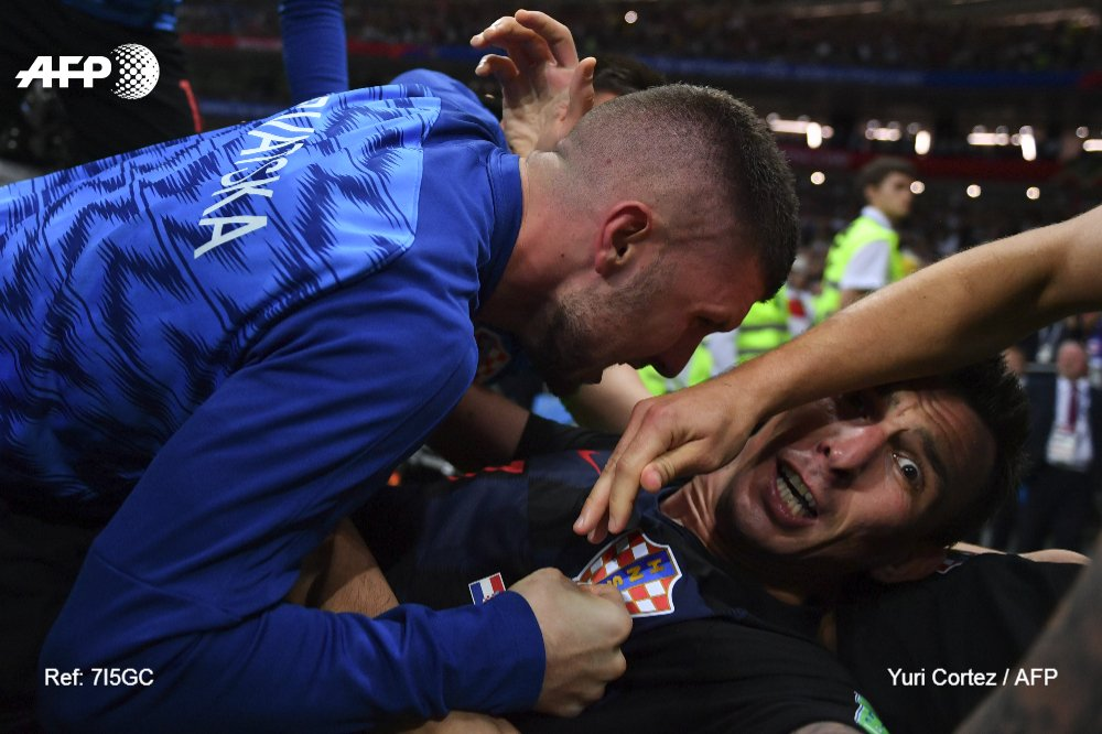 This is what it looks like when you get mobbed by celebrating Croatian players #WorldCup   �� @YuriYurisky https://t.co/5WWgrNgXXQ