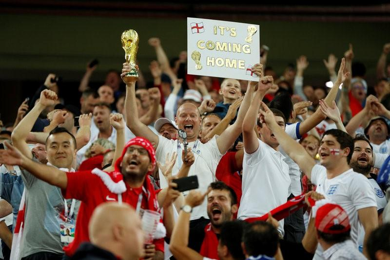 Roused and reassured, England fans come late to Russian party