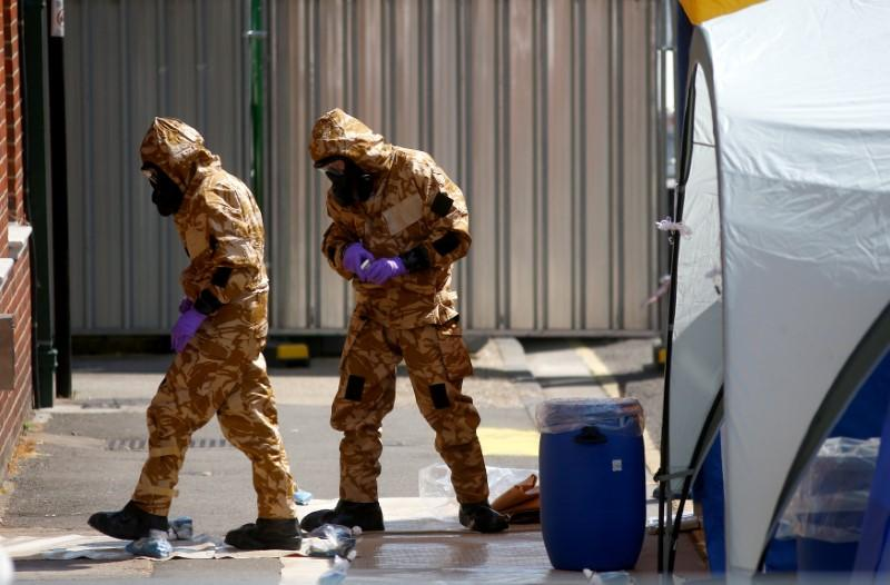 UK police in protective suits investigate latest Novichok poisoning