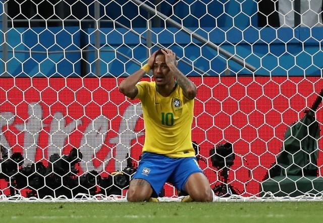 Belgium holds off Brazil fightback to reach semi-finals