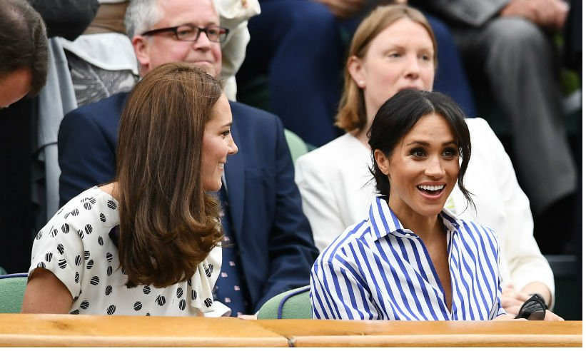 Duchesses Kate and Meghan chatted away at Wimbledon today - see the best photos: